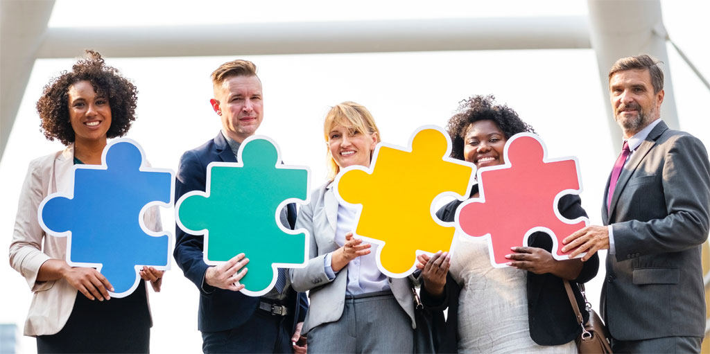 Stock photo of businesspeople and a jigsaw